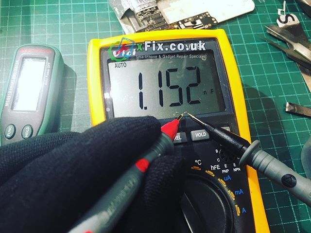 Checking the suspicious capacitors to find the faulty one from dead iPhone 6.UK